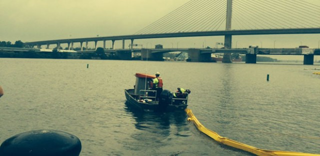 Emergency workers deploy a boom at a U.S. Coast Guard oil spill response drill in Toledo, Ohio.