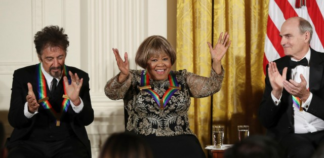 The recipients of the 2016 Kennedy Center Honors, actor Al Pacino and musician James Taylor, applaud gospel and blues singer Mavis Staples as she is recognized during a reception in their honor in the East Room of the White House in Washington, Sunday, Dec. 4, 2016, hosted by President Barack Obama and first lady Michelle Obama.