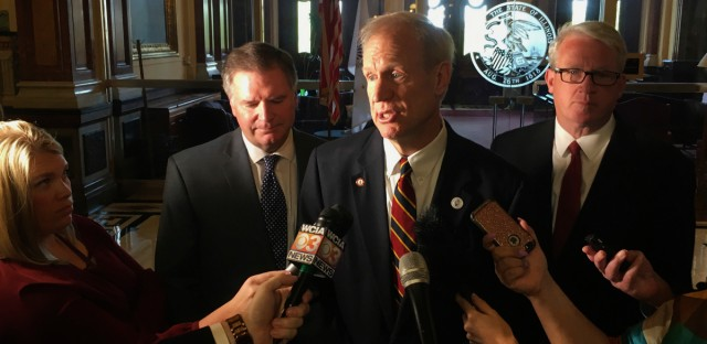 Gov. Bruce Rauner addresses reporters outside his state Capitol office in Springfield on May 8, 2018. Rauner, a Republican, wants to reinstate the death penalty in the state. He added the provision Monday, May 14, into gun legislation favored by Democrats. The bill now goes back to the Democratic-controlled Legislature for approval. (John O'Connor/AP Photo)