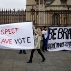 "Pro-Brexit leave the European Union supporters, left, and anti-Brexit remain in the European Union supporters take part in a protest outside the Houses of Parliament in London, Tuesday, March 12, 2019. British Prime Minister Theresa May faced continued opposition to her European Union divorce deal Tuesday despite announcing what she described as ""legally binding"" changes in hopes of winning parliamentary support for the agreement."