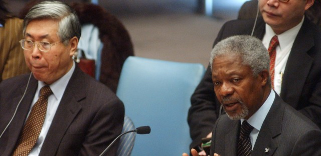 """U.N. Secretary-General Kofi Annan addresses the Security Council as it debates the problem of children in armed conflict, Tuesday, Jan. 14, 2002 at the United Nations in New York. """"The tragic fact is that children continue to be victimized in the most cynical and cruel manner in conflicts around the world,"""" Annan said during a Security Council debate. Yingfan Wang of China at left."""
