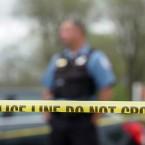 police shooting crime scene tape