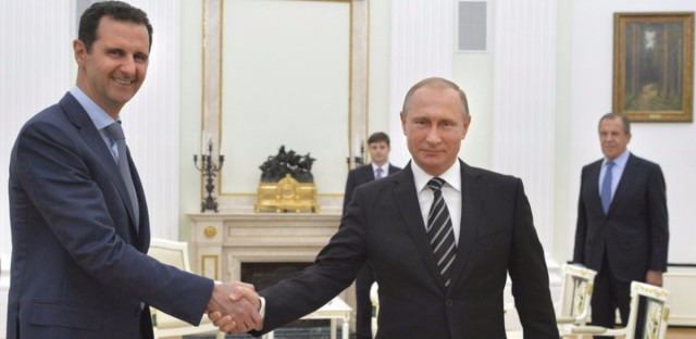 Russian President Vladimir Putin (right) hosts Syrian President Bashar Assad during a meeting at the Kremlin in Moscow. The meeting took place in October, shortly after Russia began a bombing campaign in Syria in support of Assad. Putin abruptly announced Monday that Russia was withdrawing most of its military forces.