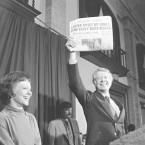 Jimmy Carter holds up an early edition of the Milwaukee Sentinel, which declared Rep. Morris Udall winner of the 1976 Democratic primary. Late returns gave the state to Carter.