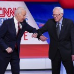 Former Vice President Joe Biden (left) and Sen. Bernie Sanders, I-Vt., greet one another before they participate in a Democratic presidential primary debate.