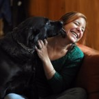 Amy Krouse Rosenthal smiles with her dog Cougar. The Chicago author died Monday at the age of 51.