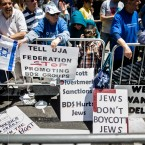 Protesters against the Boycott, Divestment and Sanctions (BDS) movement stand behind a police barricade during the Celebrate Israel Parade in New York. The international boycott movement against Israel over its treatment of the Palestinians has gained some momentum in the U.S. Once a unifying cause for generations of American Jews, Israel is now bitterly dividing Jewish communities.