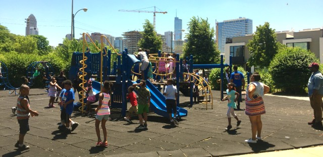 Students at Jenner Academy of the Arts enjoy a break on the playground. Jenner and a school on the Gold Coast could be merged under a proposal that will receive public hearings early next year.