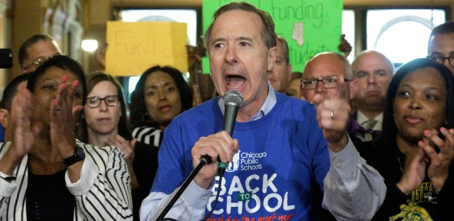 Chicago Public Schools CEO Forrest Claypool, center, earlier this year speaking to school leaders, students, parents and community members from around the state during a rally for fair education funding in the rotunda at the state Capitol.
