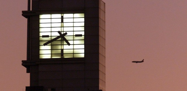 This Dec. 20, 2001 file photo shows an airplane flying past Boeing headquarters in Chicago. The FAA's oversight duties are coming under greater scrutiny after deadly crashes involving Boeing 737 Max jets owned by airlines in Ethiopia and Indonesia, killing a total of 346 people.