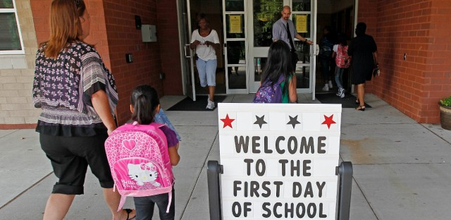 Students return for their first day of classes on a year-round calendar at Barwell Road Elementary School in Raleigh, N.C. on July 9, 2012.
