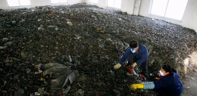 Workers sort batteries in an e-waste recycling factory in Jingmen, Hubei province, China.