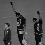 American gold medalist Tommie Smith, center, and bronze medalist John Carlos raise their fists in the air in a black power salute during the playing of the U.S. national anthem at the 1968 Olympics.