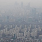 Buildings are seen shrouded in smog from the 102nd floor of Seoul's Lotte World Tower in December 2015.
