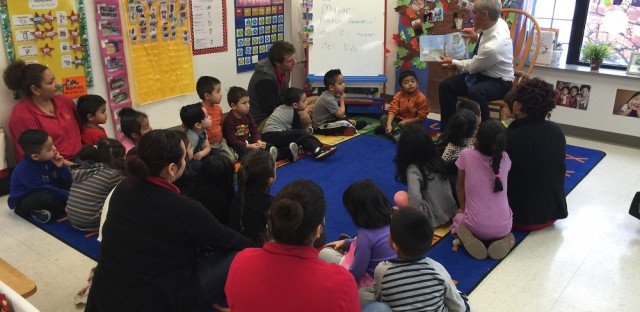 Mayor Rahm Emanuel reads to students in Pilsen Monday. Emanuel announced he'd be expanding full-day pre-kindergarten to 1,000 more students.