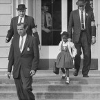 U.S. Deputy Marshals escort 6-year-old Ruby Bridges from William Frantz Elementary School in New Orleans in November 1960. The first grader was the only black child enrolled in the school, where many parents of white students boycotted the court-ordered integration law and took their children out of school. (AP Photo)