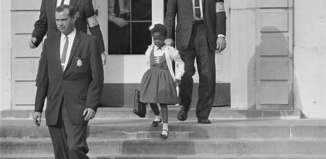 U.S. Deputy Marshals escort 6-year-old Ruby Bridges from William Frantz Elementary School in New Orleans in November 1960. The first grader was the only black child enrolled in the school, where many parents of white students boycotted the court-ordered integration law and took their children out of school.
