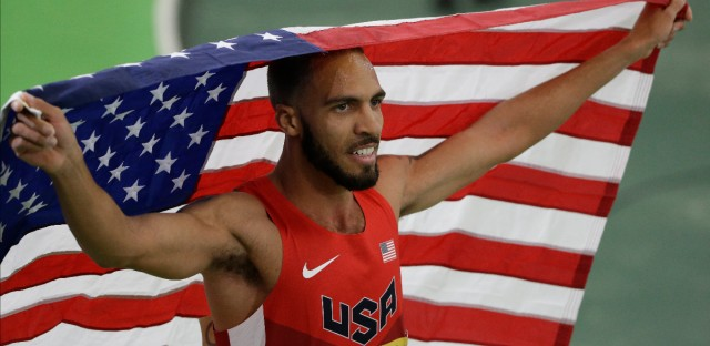 The United States' Boris Berian holds the U.S. flag after he won the men's 800-meter sprint final during the World Indoor Athletics Championships, in Portland, Ore.