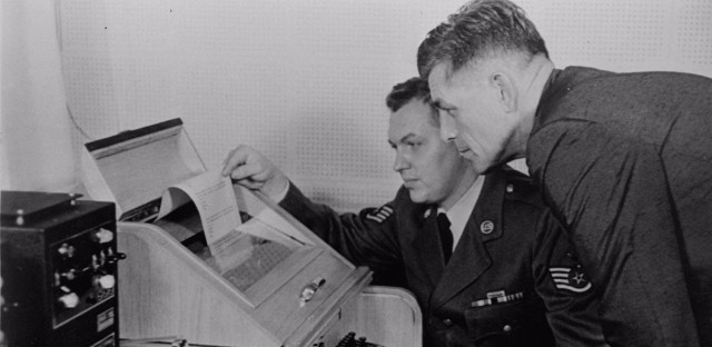 "The White House Kremlin ""hot line"" providing direct communication for emergency use by the Chief of Staff in Washington and Moscow, became operational August 30, 1963. Air Force Sgt. John Bretoski, left, and Army Lt. Col. Charles Fitzgerald, man the equipment in the Pentagon during a test run. The Pentagon is the U.S. operating terminal for both the land line-transocean circuit and the alternate radio circuit, with a direct relay to the White House. (AP Photo)"