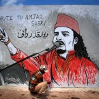 A Pakistani painter gives final touches to a mural of slain Sufi singer Amjad Sabri to pay homage to him, in Karachi, Pakistan. Sabri, a well-known Pakistani Sufi singer who was shot dead in the port city of Karachi in an attack on last week claimed by Islamic extremists.
