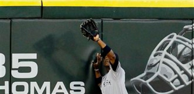Curtis Granderson catches a fly ball at U.S. Cellular Field.