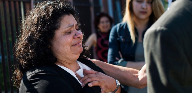 Lourdes Salazar Bautista puts her hands to her heart as she expresses concern for her children, moments after leaving the meeting confirming her deportation order on Monday, July 31, 2017 outside the ICE Enforcement and Removal Operations Office in Detroit, Michigan.