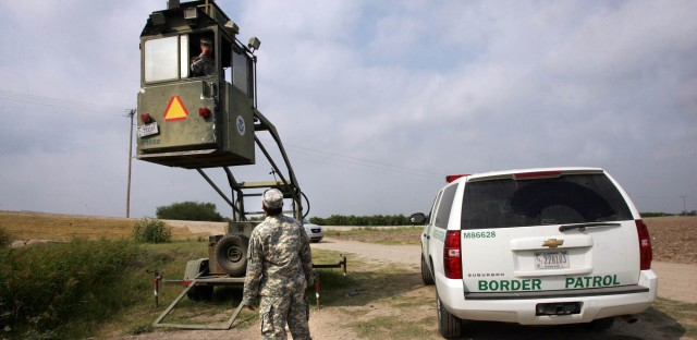 A member of the National Guard checks on his colleague inside a Border Patrol Skybox near the U.S.-Mexico border in Hidalgo, Texas, in 2011. President Trump is calling for troops on the Southern border, something the past five presidents have all done on a limited basis.