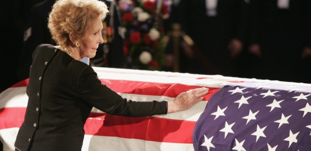 Mrs. Reagan touches the coffin of her husband during his state funeral on Capitol Hill on June 9, 2004. Ronald Reagan died after a long struggle with Alzheimer's disease.
