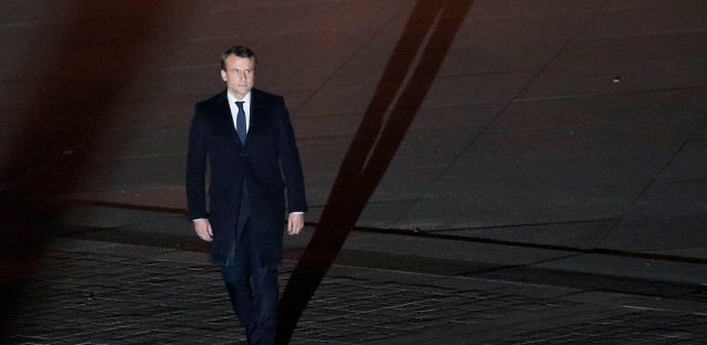 Incoming French President Emmanuel Macron walks towards the stage to address his supporters at the Louvre Palace in Paris, Sunday May 7, 2017. Polling agencies have projected that centrist Macron will be France's next president, putting a 39-year-old political novice at the helm of one of the world's biggest economies and slowing a global populist wave. (AP Photo/Christophe Ena, Pool)