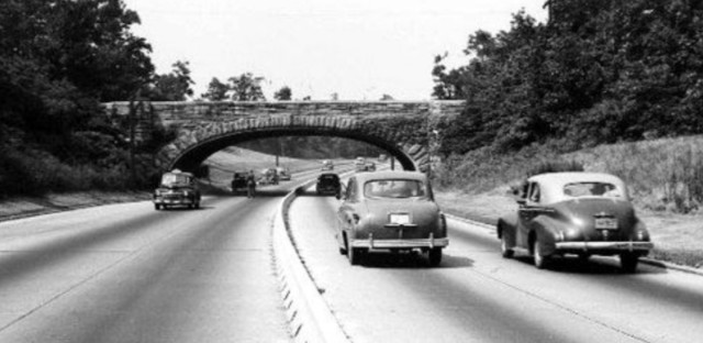 When road-building technology advanced, and White Flight took over America's major cities, engineer Robert Moses designed low bridges to discourage public transit between New York City and its suburbs. Critics suggest this design was intentionally racist, to prevent Black city-dwellers who could not afford to buy cars from visiting the suburbs.
