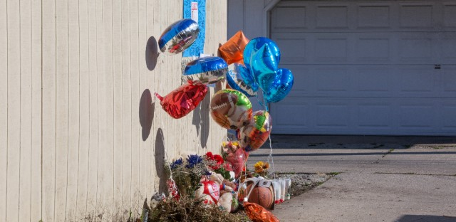 A makeshift memorial sits Wednesday, Nov. 4, 2015 where Tyshawn Lee was fatally shot in Chicago. Lee, 9, was shot Monday in the Auburn Gresham neighborhood.