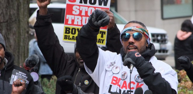 Kofi Ademola of Black Lives Matter Chicago speaks at a rally in the Magnificent Mile shopping district  in 2017. Protesters were calling for an elected civilian police review board.