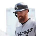 Chicago White Sox' Adam LaRoche smiles after he scored on a single by Alexei Ramirez off Minnesota Twins pitcher Kyle Gibson in the fourth inning of a baseball game, Thursday, Sept. 3, 2015, in Minneapolis.