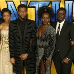 Actors Michael B. Jordan, Leitia Wright, Chadwick Boseman, Lupita Nyong'o, Daniel Kaluuya and Danai Gurira pose for photographers upon arrival at the premiere of the film 'Black Panther' in London, Thursday, Feb. 8, 2018.