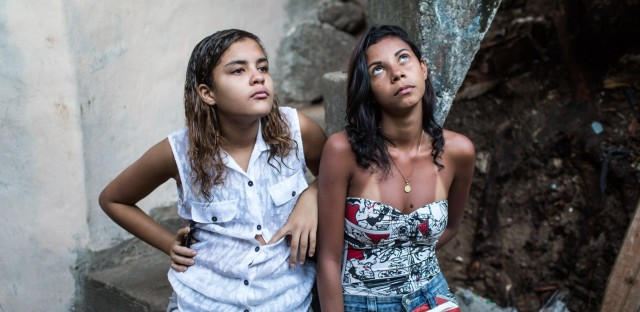"""Soccer buddies Lahis Maria Ramos Veras, 14 (left), and Milena Medeiros dos Santos, 16, don't let taunts keep them from playing. Lahis goes by the nickname """"Lala."""""""