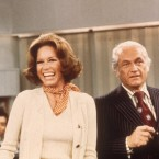 Actors Mary Tyler Moore and Ted Knight laugh in a still from the television series, The Mary Tyler Moore Show, in 1976.