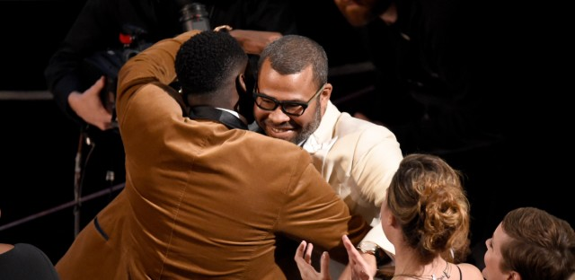 "Daniel Kaluuya, left, congratulates Jordan Peele, winner of the award for best original screenplay for ""Get Out"" at the Oscars on Sunday, March 4, 2018, at the Dolby Theatre in Los Angeles."