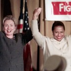 Then first lady Hillary Rodham Clinton raises hands with then U.S. Sen. Carol Mosely-Braun and other Democratic candidates at a Women's Issues rally in 1998 in Chicago. Mrs. Clinton was making an appearance for the Illinois candidates in the upcoming election in November.