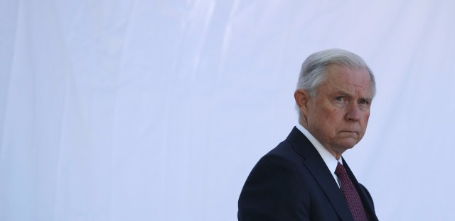"""Attorney General Jeff Sessions waits to be introduced during a service at the National Law Enforcement Officers Memorial on May 9 in Washington, D.C. Sessions issued an order on Monday narrowing the scope of his financial threat to """"sanctuary cities."""""""