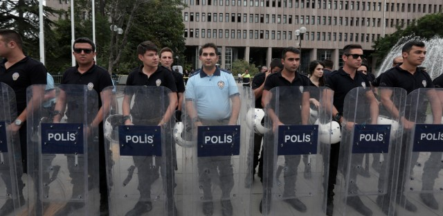 Turkish riot police stand guard outside a courthouse where prosecutors are questioning hundreds of coup plotters, in Ankara, Turkey, Wednesday, July 20, 2016. Turkey's National Security Council is holding an emergency meeting following a coup attempt last week that was derailed by security forces and protesters loyal to the government. President Recep Tayyip Erdogan was heading the meeting Wednesday of the council, which is the highest advisory body on security issues.