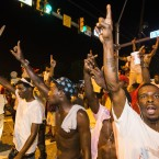 Protesters march near the convenience store where Alton Sterling was shot and killed, July 6, 2016 in Baton Rouge, Louisiana.
