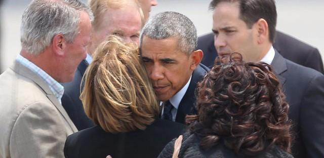 President Obama hugs Orange County Mayor Teresa Jacobs as Orlando Mayor Buddy Dyer, left, watches, at Orlando International Airport on Thursday.