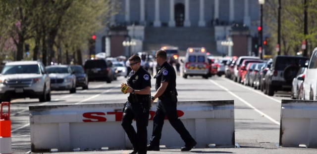 Police establish a perimeter during a lockdown after shots were reportedly fired at the U.S. Capitol Visitor Center on Monday.