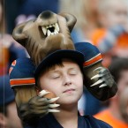 A Chicago Bears fan watches during the second half of an NFL football game between the Chicago Bears and the Detroit Lions, Sunday, Oct. 2, 2016, in Chicago
