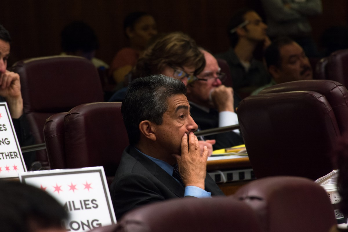 Daniel Solis is framed among chairs in City Council.