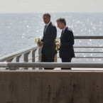 President Barack Obama and Argentine President Mauricio Macri walk up to the end of the barrier before tossing roses into the river during their visit to Parque de la Memoria (Remembrance Park) in Buenos Aires, Argentina, Thursday, March 24, 2016. Obama visited the memorial to victims of the country's murderous US-backed dictatorship who were killed or went missing from 1976-1983.