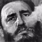 Fidel Castro exhales cigar smoke during a March 1985 interview at his presidential palace in Havana. Ailing leader Fidel Castro resigned as Cuba's president early Tuesday Feb . 19, 2008, saying in a letter published in official online media that he would not accept a new term when the newly elected parliament meets on Sunday.