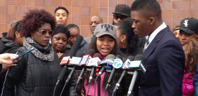 Fifteen-year-old Kaya Raye (center) talks to reporters about the fatal police shooting of her brother, Kajuan.