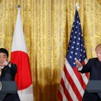 President Donald Trump and Japanese Prime Minister Shinzo Abe both gesture as they take questions from members of the media during their joint news conference in the East Room of the White House in Washington, Friday, Feb. 10, 2017.