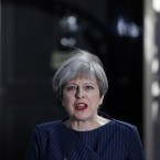 Britain's Prime Minister Theresa May speaks to the media outside her official residence of 10 Downing St. in London on Tuesday. May announced she will seek early elections to be held June 8.